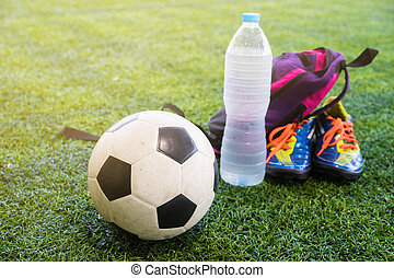 Football and fresh water after the match on the field