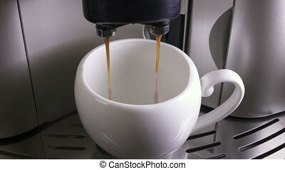 Coffee flows in a cup .