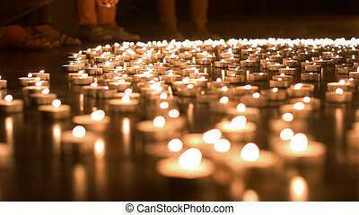 One Person Placing Candle to the Group of Candles -...
