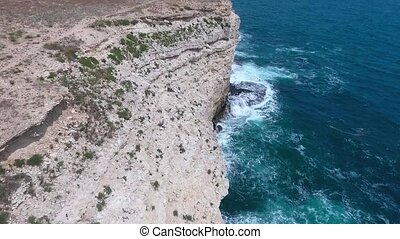 Aerial shot from flying drone. Rocks of sea coastline. Full...