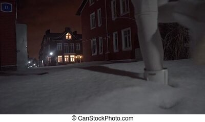 Woman walking in snowdrifts in the evening clip