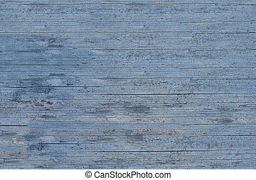 Old wooden blue painted surface. The paint is faded and...