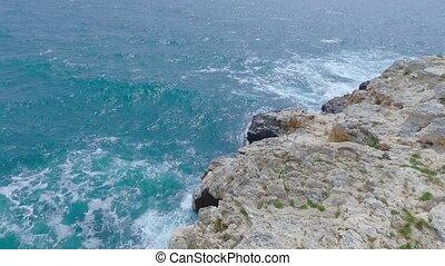 Aerial footage of sea rocks.