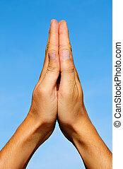 praying - men hands together symbolizing prayer and...