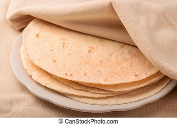 Tortilla - Stack of tortilla covered with neat cloth