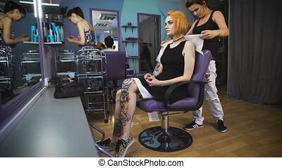 Beautiful girl in the client's chair beauty salon.