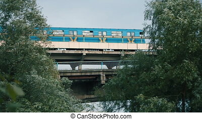 metro train going over the bridge - metro train going over a...