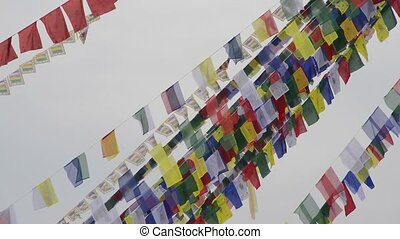 Prayer flags in Nepal - Buddhist prayers flags flying in the...