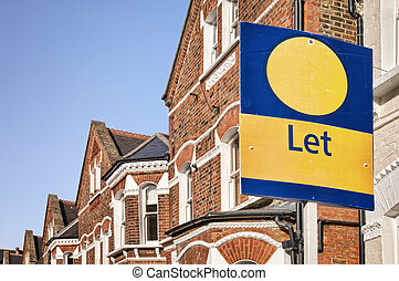 "A typical red-brick townhouse with "" Let\"" sign and copy..."