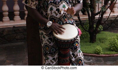 African man plays African drums