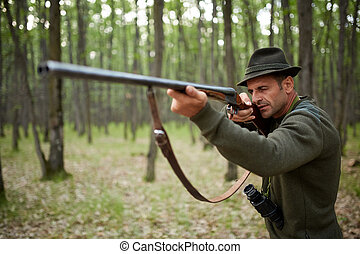 Hunter with shotgun in the forest - Hunter with double...