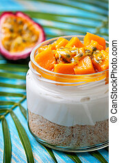 cheesecake in a  jar with mango and passionfruit