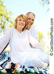 Mature couple smiling Focus on the woman