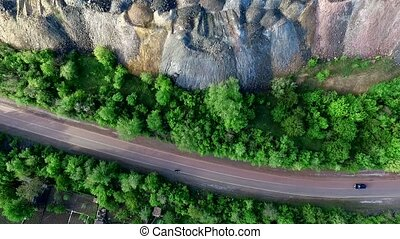 beautiful landscape with road and settlements and plants on...