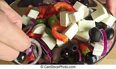 Mixing Greek salad close up video clip