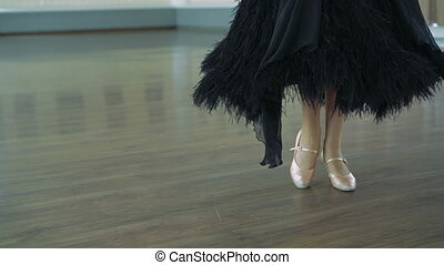 The legs of a girl in ballroom dancing. 4K