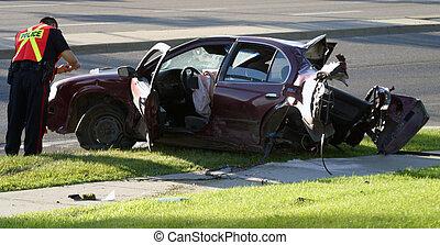 car wreck - An Edmonton, Alberta police officer investigates...