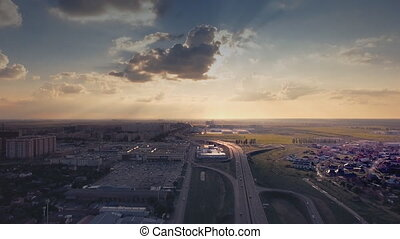 Aerial view of highway interchange and dark clouds