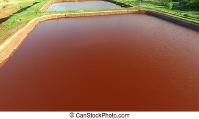 Red lakes in Kryvyi Rih, Ukraine, aerial photo - Red lakes...