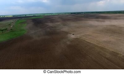 plowing field in spring - harvester plowing field in spring,...