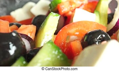 Greek vegetable and cheese salad close up dolly shot,...
