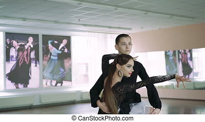 Professional dancers dancing in ballroom. Latin. 4K -...