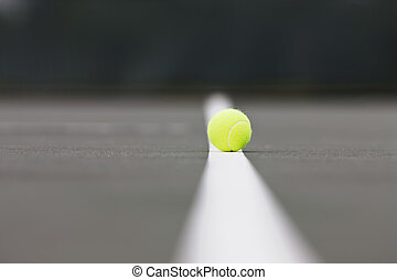 Tennis Balls - Tennis balls sitting on the ground at a...