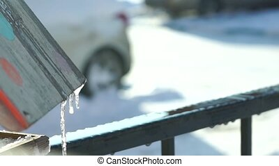 Drip of thawing snow in residential area, 120 fps slow...