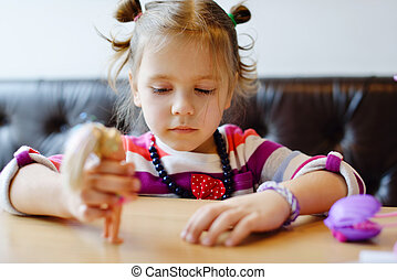 girl playing dolls - little girl playing dolls under the...