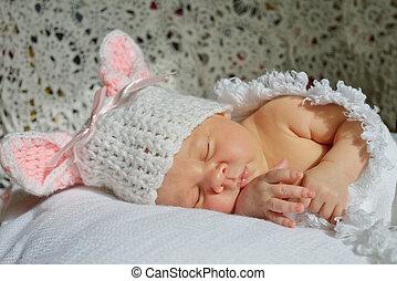 sweet little newborn sleeping on the sun
