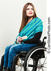 Invalid girl on wheelchair combing hair - Real people,...