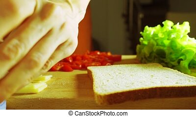 Girl hand spreading soft cheese on a slice of bread