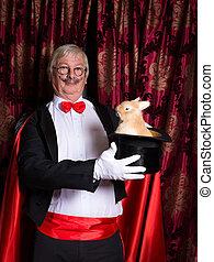 Happy illusionist with rabbit