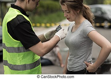 Accident perpetrator during breathalyzer test - Photo of...