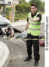 Roadside assistance worker - Image of car accident and...