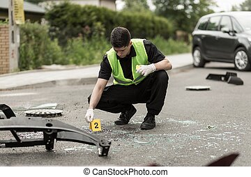 Police officer securing accident scene - Image of police...