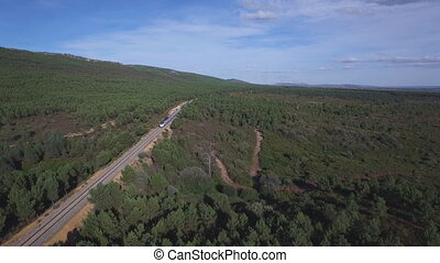 Train in the wild, elevating camera - Aerial view of train...