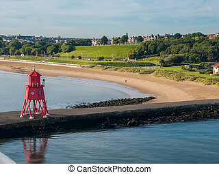 Lighthouse at harbor of Newcastle, England - Red-colored...