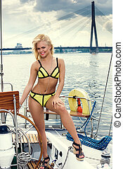 beautiful woman in swimsuit on yacht - Young beautiful woman...
