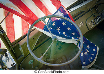 ww2 military vehicle with American flag - a ww2 military...