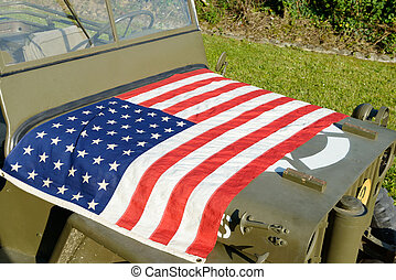 ww2 military vehicle with American flag