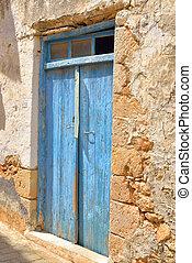 Door of an old building in Hersonissos - Door of an old...