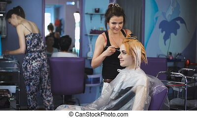 Professional hair color salon Pretty and smiling girl came...