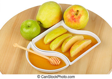 apples and honey - apples and dipping slices of apple in...