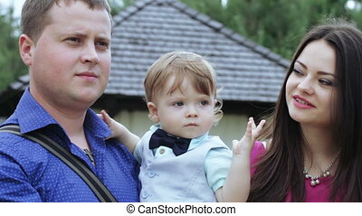 Young family is photographed - On nature of young couple is...