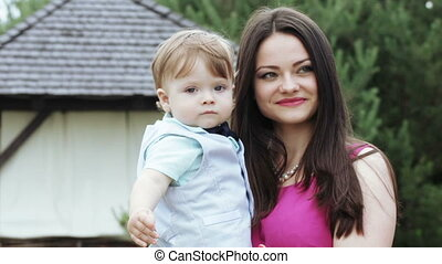 Mother and son is photographed - On nature of young mother...