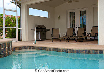 sitting area at pool - looking across a large built in pool...