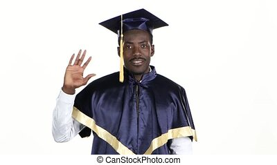 High school alumni. Graduate in graduation gown. White....