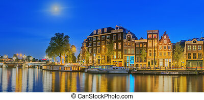 Amstel river, canals and night view of beautiful Amsterdam...