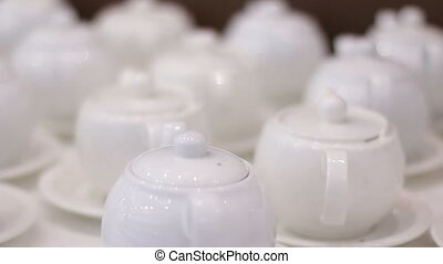 White teapots on a table